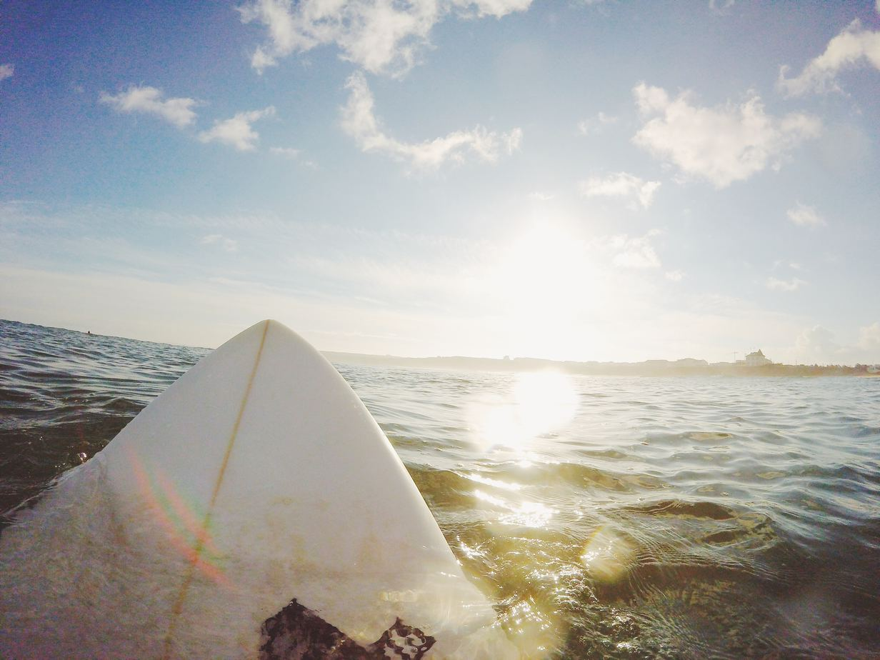 surfboard bobbing in ocean
