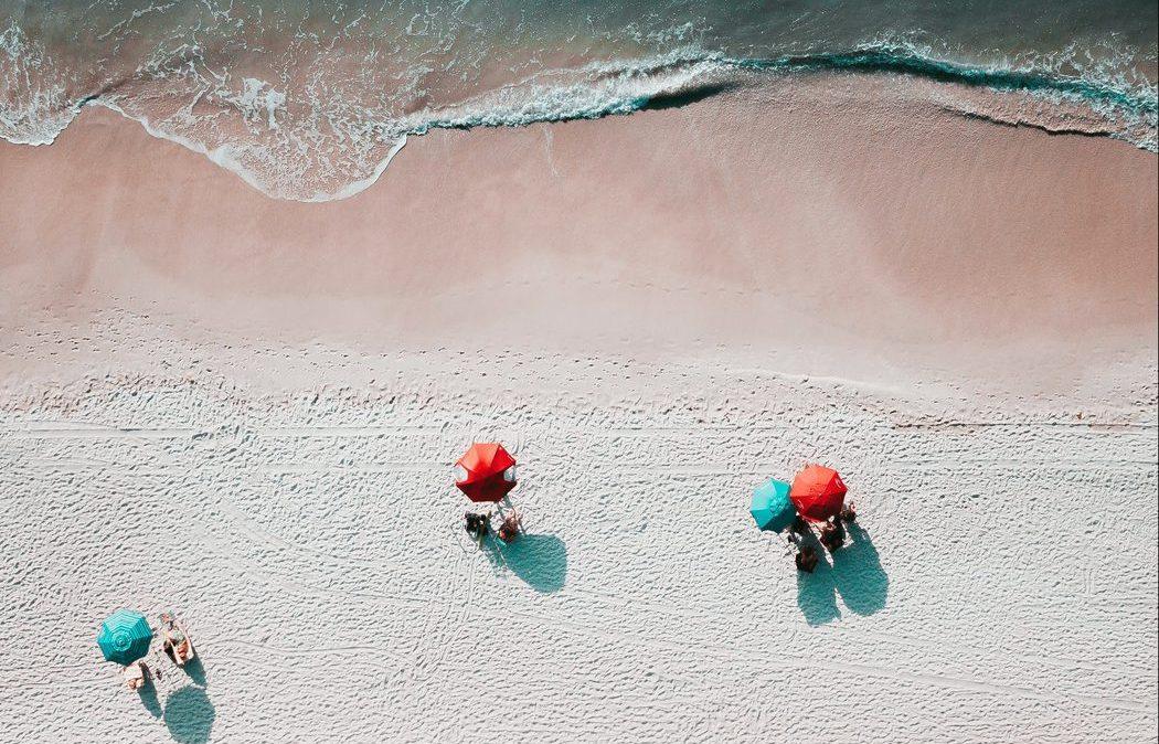 aerial view of beach and sun umbrellas