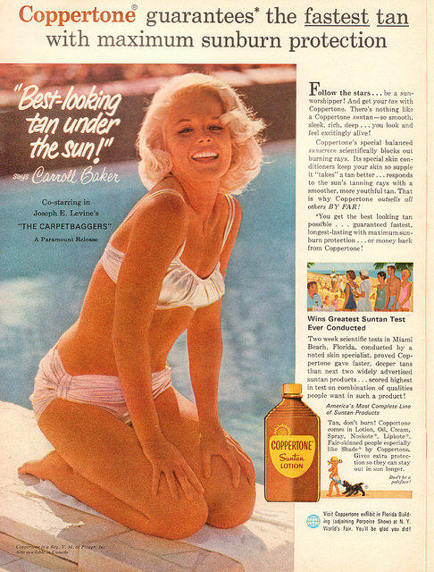 1970's photo of woman in swimsuit putting on tanning lotion.