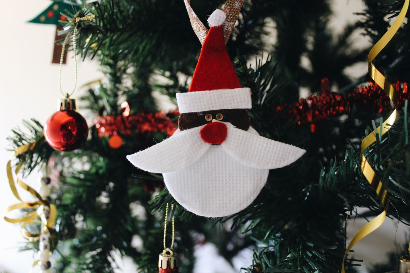 Santa Christmas ornament hanging on tree