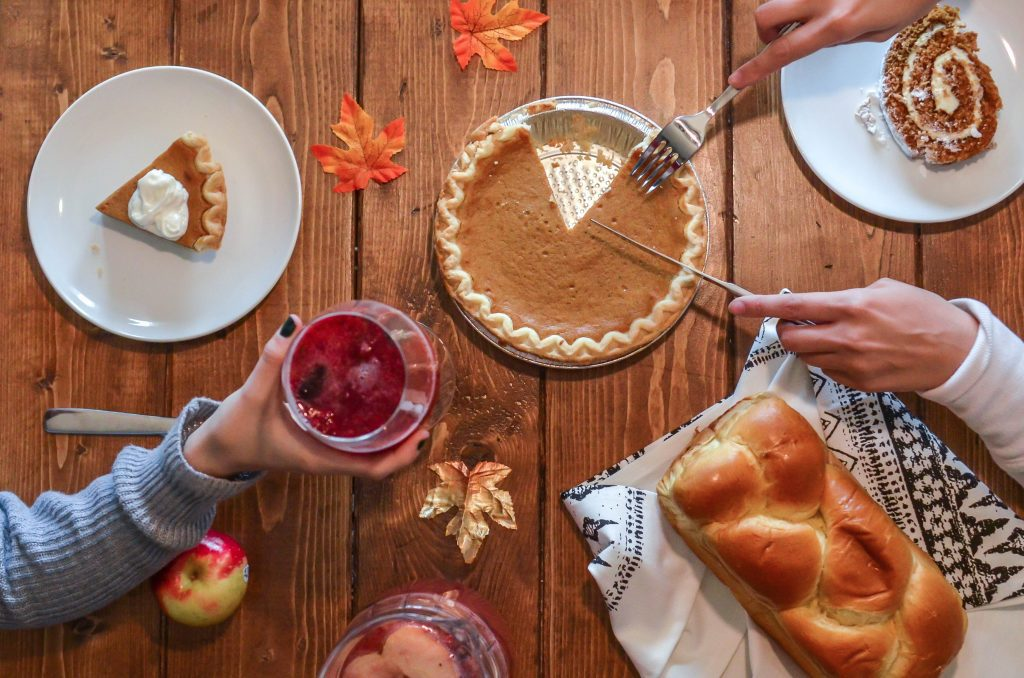 holiday meal with pumpkin pie on table