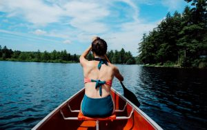 mom having a solo canoe paddling adventure without kids