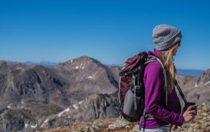 why moms need more adventure woman backpacking in mountains