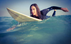 woman on surfboard learning to surf